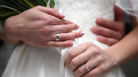 wedding bouquet, bride's hands, wedding rings Footage