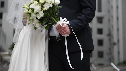 wedding bouquet, bride's hands, wedding rings ビデオ