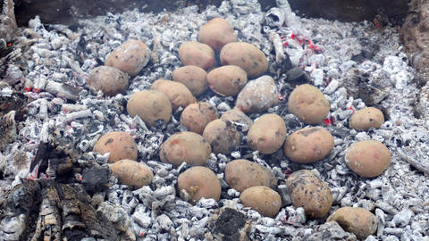 Baked potato in fire Footage