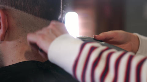 Male haircut with electric razor. Close up of hair trimmer hairstyle Live Action