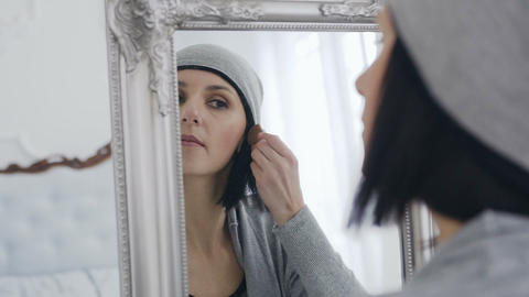 Beautiful brunette girl doing makeup. White room and... Stock Video Footage