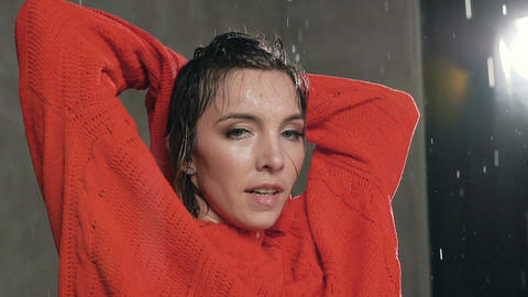 Sexy dancer girl in red sweater dancing emotional modern dance under the water Live Action