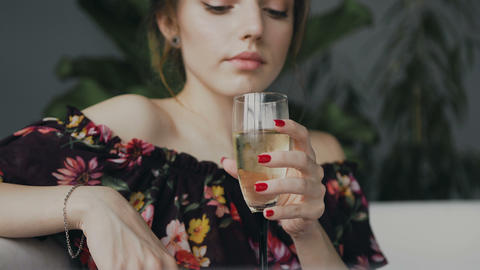 Portrait of a cute young woman who drinking champagne in the bathroom. Young Live Action