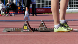 Feet girl runner stands next to starting blocks before start Footage