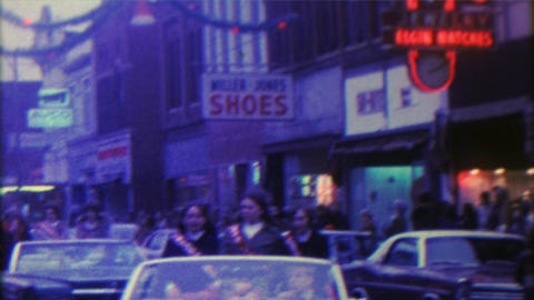 1967: Christmas parade small downtown city old timey storefronts Footage