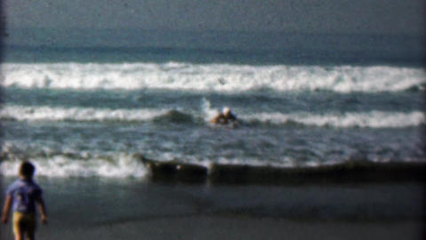 1958: Women early boogie board style body surfing inflatable mattress Footage