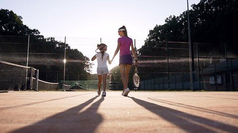 Female coach and her female pupil walking on the court Footage