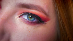 Closeup of attractive female blue eyes makeup with pink shades and charming Footage