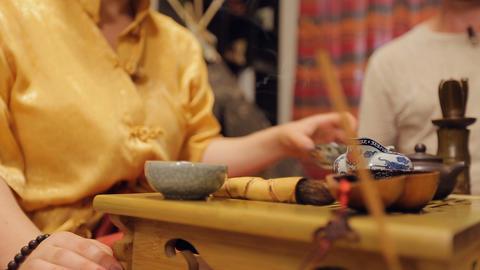 Tea ceremony lady master serving drinking pots, exotic spiritual etiquette Live Action