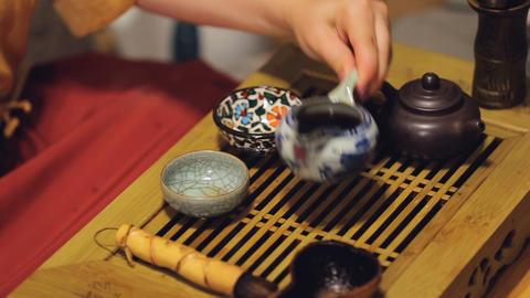 Male guest taking bowl participating Japan tea ritual event, spiritual content Live Action