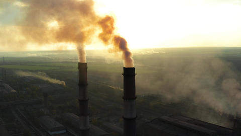 Polluting factory at dawn Footage