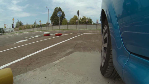 Vehicle starting driving examination, demonstrating turning maneuvering, safety Footage