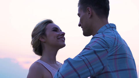 Young man and woman enjoying time together kissing sunset, honeymoon, connection Live Action