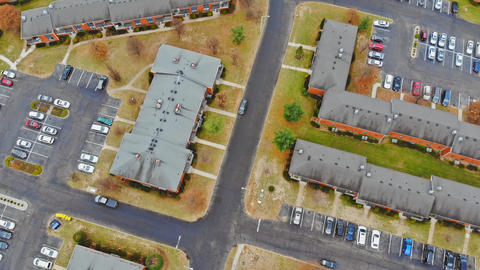 Aerial shot looking down on urban housing development - housing estate of yellow Live Action