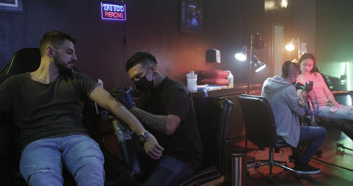 Job Profession Work With Man Drawing Tattoo In Beauty Studio Footage