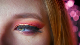 Closeup of amazing female blue eye makeup with pink shades and gold eyeline. Eye Footage