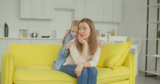 Affectionate daughter comforting her upset mother Footage