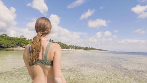 Portrait beautiful woman in summer bikini enjoying sea water on paradise beach Footage