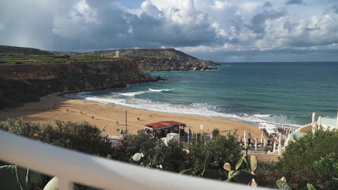 Amazing views of the beach in Malta. Beautiful sandy beach, small hills and Live Action