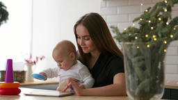 family, technology and motherhood concept - happy smiling young mother with Footage