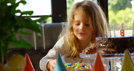 Cute girl prepare to decorate birthday cake at home 4k Live Action