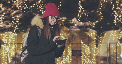 Woman using smart phone at night in city, blurred Night Busy Street lights Live Action