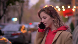 Side portrait of young blonde caucasian girl interestedly talking on cellphone Footage