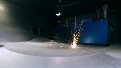 Modern 3D printer printing an object from the metal powder Footage