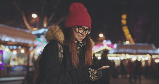 Portrait of young beautiful caucasian woman using smart phone hand hold outdoor Footage