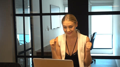 Depressed Business Blonde Woman having a problem in front of a laptop Live Action