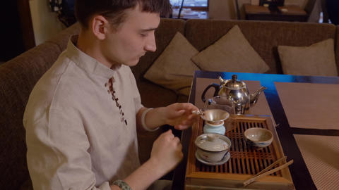Man preparing traditional japanese tea on tea tray while ceremony Live Action