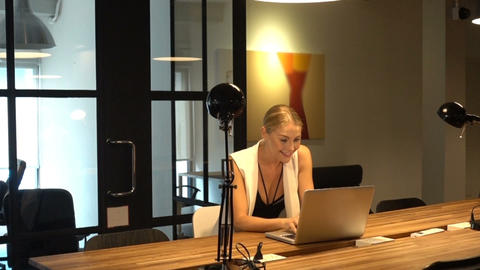 Business Blonde Girl Writing a business plan in front of a laptop Footage