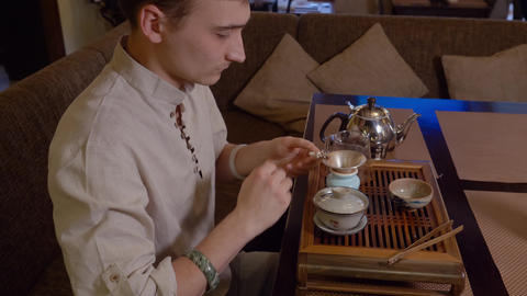Master preparing japanese tea on tea table while traditional ceremony Live Action
