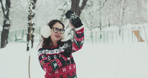 A girl makes selfie using a smartphone in the winter forest Footage