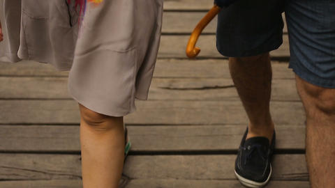 Boyfriend and girlfriend legs walking upstairs to restaurant, romantic date Live Action