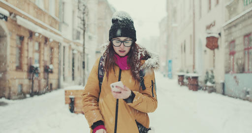 Cheerful trendy hipster girl feeling excited with winning discount for shopping GIF