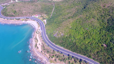 Aerial view of coast road and blue ocean Footage