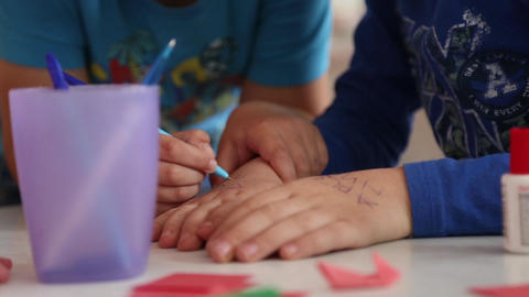 Children draw with a pen on hand Footage