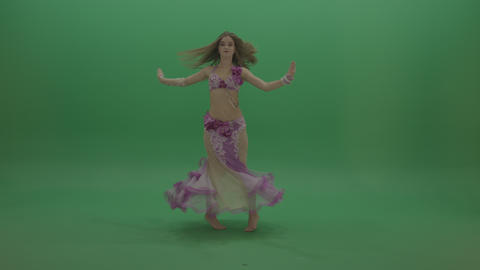 Sightly belly dancer in pink wear display amazing dance moves over chromakey Live Action