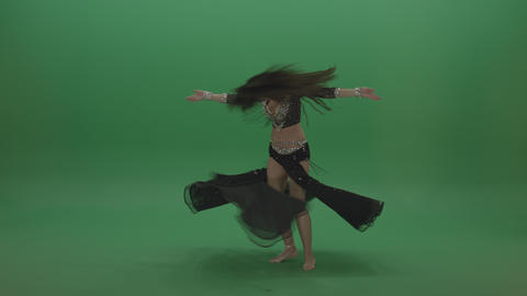 Beautiful belly dancer in black wear display amazing dance moves over chromakey Footage