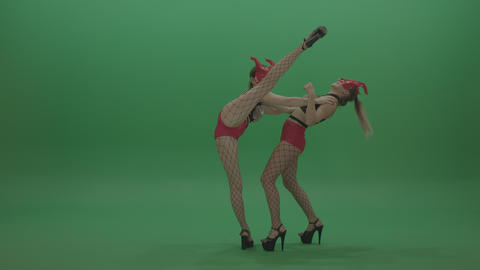 Attractive PJ Demons Go Go Dancers in Red Mask on Green Screen Stock Footage