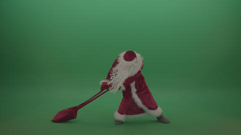 Santa drags the heavy gift bag across chromakey background Footage