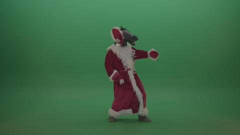 Scary santa with horse head dances creepily over chromakey background Live Action