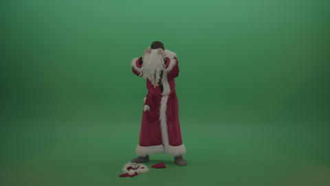 Man takes off his santa costumes over green screen background ライブ動画