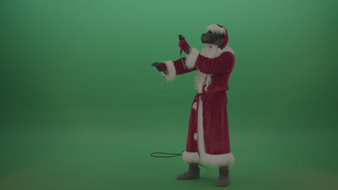 Santa with VR gears shoots imaginary gun around over chromakey background1 Live Action