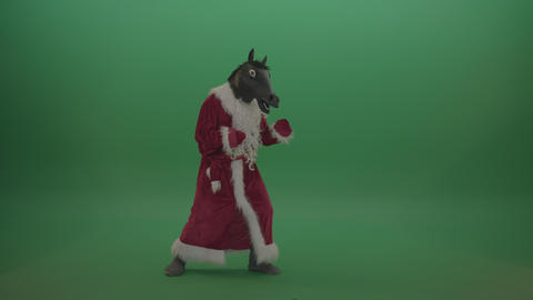 Horse head santa displays his fight techniques over chromakey background Live Action