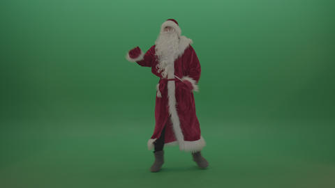 Man in santa clause costume standing and staring at the camera over green screen Live Action