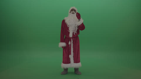 Man in santa costumes operates invisible screen over grren screen background Footage