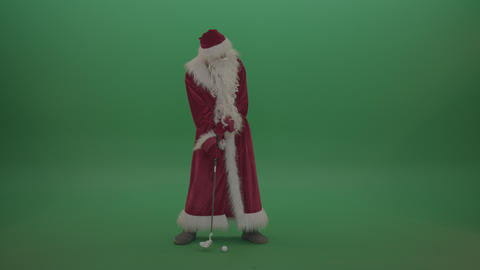 Man in santa clause costume plays golf over green screen background Footage