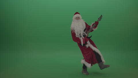 Happy santa plays his guitar in a stylish fashion over chromakey background Live Action